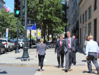 Pedestrians crossing a street in Downtown Raleigh